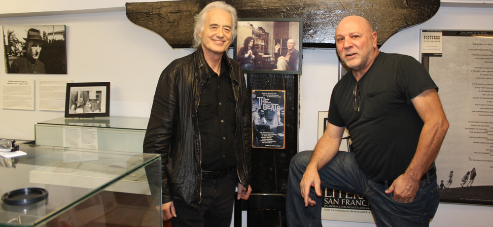 Jimmy Page and Jerry Cimino next to Charles Gatewood's 1975 photo