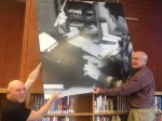 Robert Carlson, SFPL North Beach Branch Manager, and Jerry Cimino removing the photo panels from the library wall.