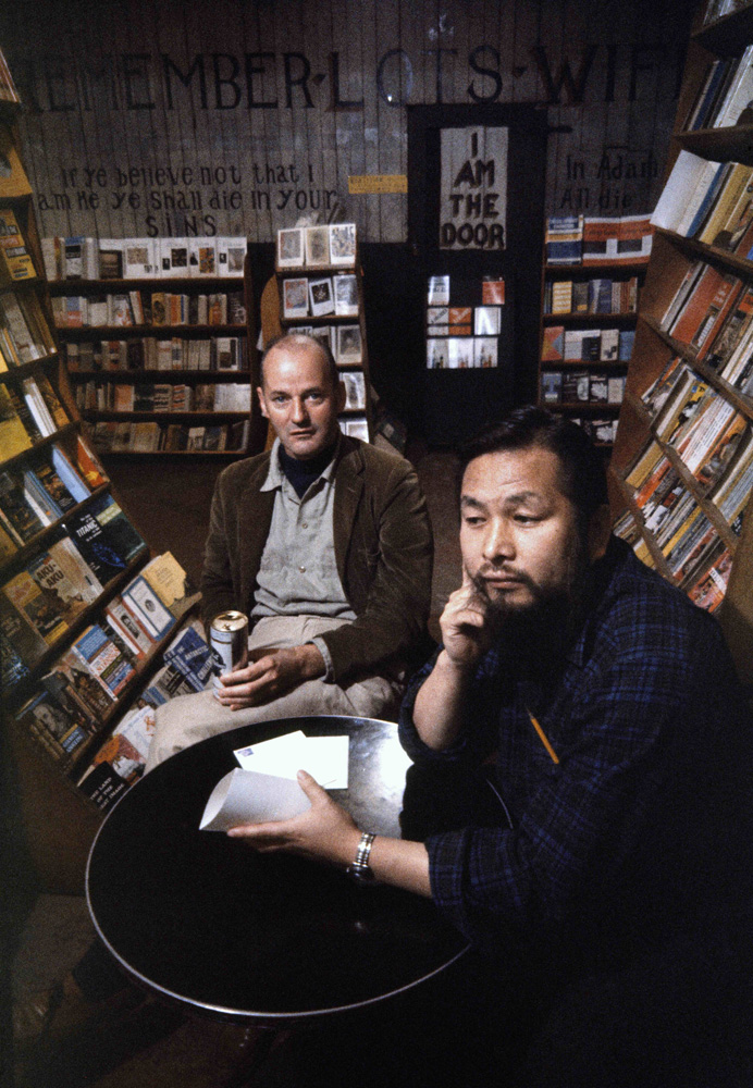 Ferlinghetti & Shig in the basement of City Lights. Photo by Burt Glinn