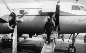 John F. and Jackie Kennedy climb aboard the Caroline