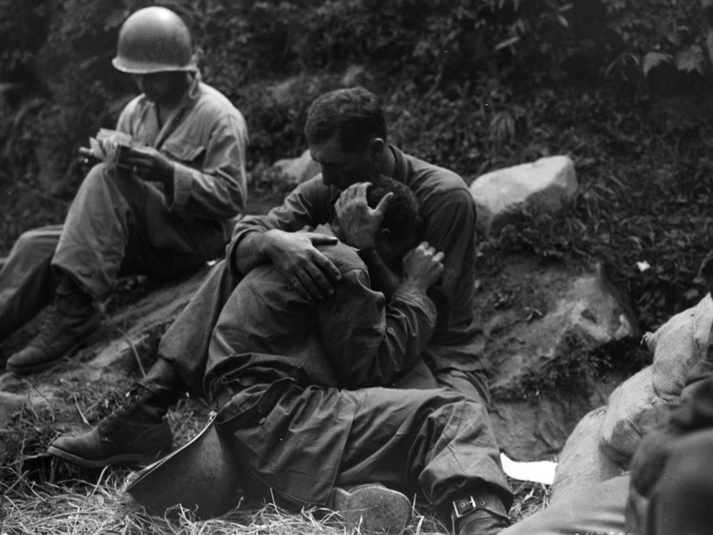 A soldier comforts a comrade