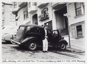 "Peter Orlovsky with his and Allen's first car ""The Hearse"" around the corner from 1010 Montgomery"